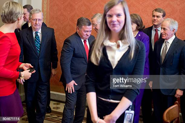Jordanian King Abdullah II red tie talks with Senate Minority Leader Harry Reid DNev before a meeting with Senators in the Capitol January 12 2016