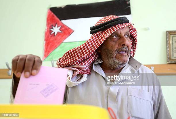 A Jordanian man casts his ballot at a polling station in the capital Amman on September 20 2016 during parliamentary elections Jordanians are voting...