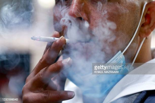 Jordanian man smokes a cigarette in the capital Amman,on March 17, 2021. - With already one of the world's highest rates of smokers, Jordan has seen...