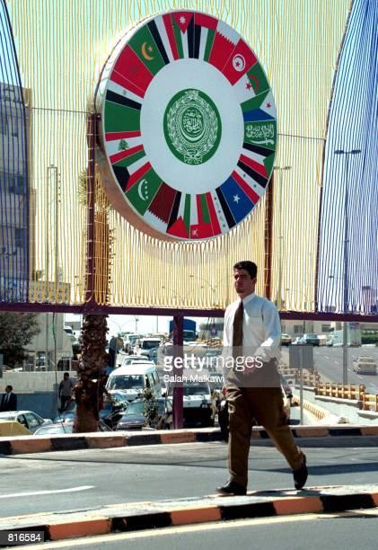 Jordanian man walks under a banner of the Arab League announcing the March 2728 Arab summit March 22 2001 in Amman Jordan Saudi Arabia has decided to...