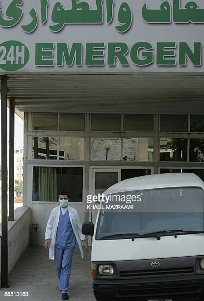 A Jordanian medic wearing a mask walks out of the emergency ward of a hospital in Amman on June 16 2009 Jordan has recorded its first cases of swine...