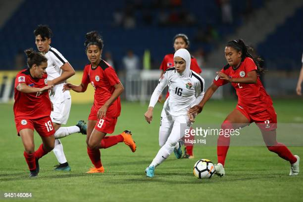 Jordanian Midfielder Shahnaaz  Jebreen is tackling several Philippine players in the opening match of the AFC Asian Cup between Jordan and...