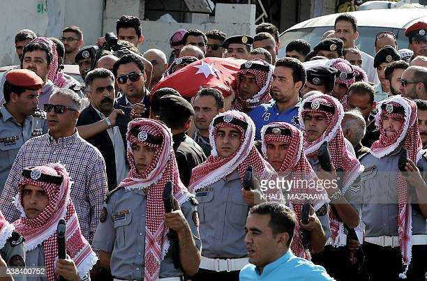 Jordanian mourners carry the body of intelligence corporal Omar alHayari one of the five Jordanian intelligence agents killed during a gun attack at...