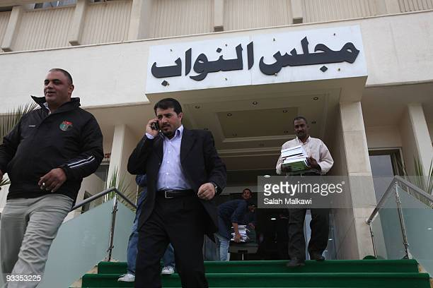 Jordanian MPs leave in front of parliament employees packing their belongings after parliament was dissolved at the Jordanian Parliament offices on...