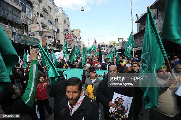 Jordanian Muslim Brotherhood supporters attend a protest to demand the release of detained Zaki Bin Irsheid, Secretary General of Islamic Action...