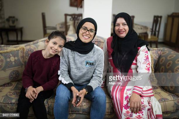 Jordanian National Midfielder Shahnaaz Jebreen her mother Khoula Jebreen and her sister Lojain Jebreen are posing in the reception room on March 30...