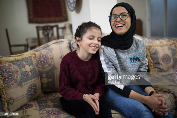 Jordanian National Midfielder Shahnaaz Jebreen smiles with her sister Lojain Jebreen on March 30 2018 in their home in Amman Jordan one week before...