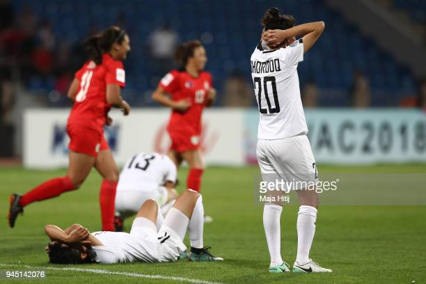 Jordanian national players Shorooq AlShathly and Maysa Jabarh react after after the opening match of the AFC Asian Cup between Jordan and Philippines...