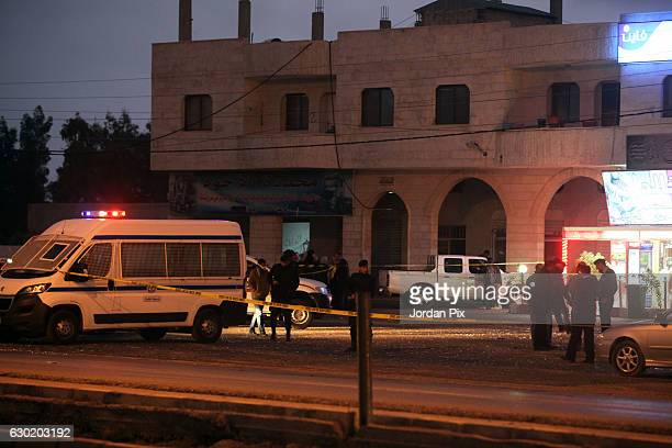 Jordanian police inspect the scene in AlQatranah where ISIS attackers first opened fire on the arriving policemen killing two and escaping to the...