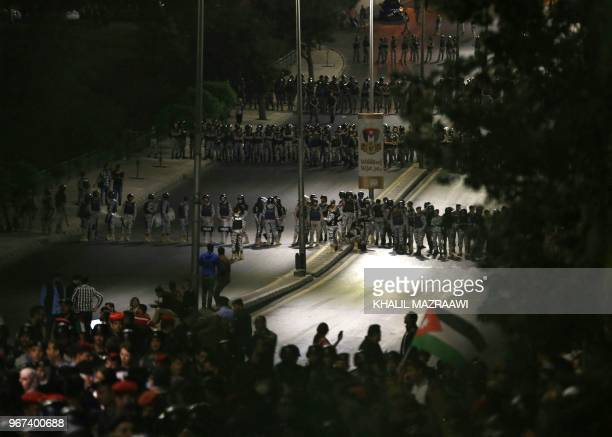 Jordanian police officers secure the office of the prime minister during a demonstration in the capital Amman late on June 4 2018 Jordanian Prime...