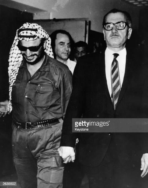 Jordanian Premier Abdul Monem Rifai , walking hand in hand with Yasser Arafat, head of the Palestine Liberation Organisation after a peace treaty was...