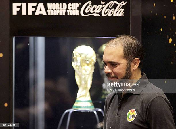 Jordanian Prince Ali Bin alHussein FIFA vicepresident pose for a photograph after the unveiling of the FIFA World Cup trophy during the FIFA World...