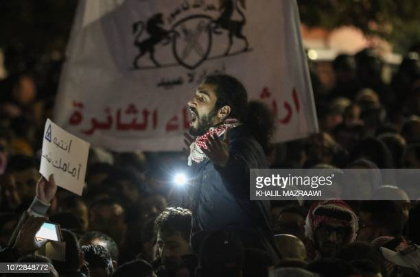 A Jordanian protester chants slogans in the capital Amman on December 13 during a demonstration against the government's decision to raise the income...