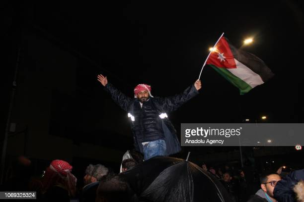 Jordanian protester holds a flag during a demonstration against the government's decision to raise taxes in the capital Amman Jordan on December 06...