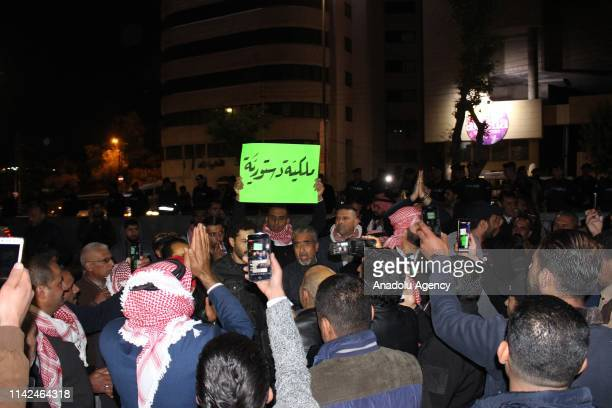 Jordanian protesters chant slogans and hold banners during a demonstration in the capital Amman Jordan on May 09 2019