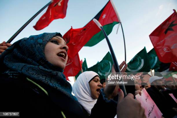Jordanian protesters from the Islamic Front left wing parties and women activists protest against the naming of the new Prime Minister Marouf Bakhit...
