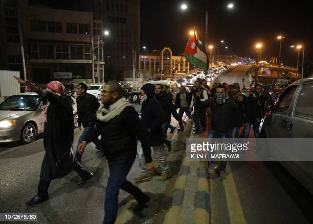 Jordanian protesters march during a demonstration against the government's decision to raise taxes in the capital Amman on December 13 2018 The tax...