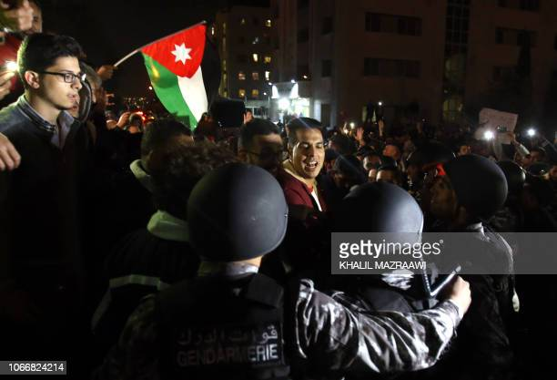 Jordanian protesters scuffle with riot police during a demonstration against the government's decision to raise taxes in the capital Amman on...
