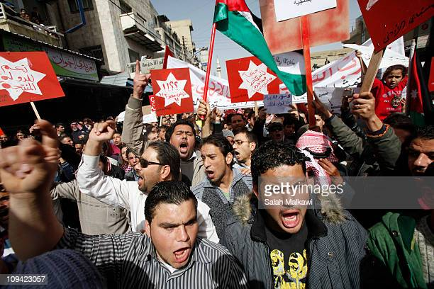 Jordanian protesters shout anti government slogans in the streets of downtown on February 25 2011 in Amman Jordan Tens of thousands Jordanians took...