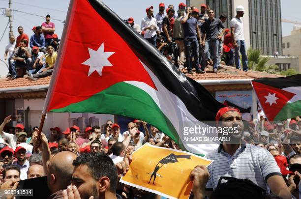 Jordanian protesters wave national flags and shout slogans during an antiausterity rally on June 6 in front of the Labor Union offices in Amman...