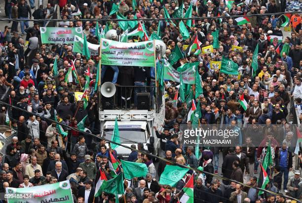 Jordanian protesters wave Palestinian and Muslim Brotherhood flags during a demonstration against the US president's decision to recognise Jerusalem...
