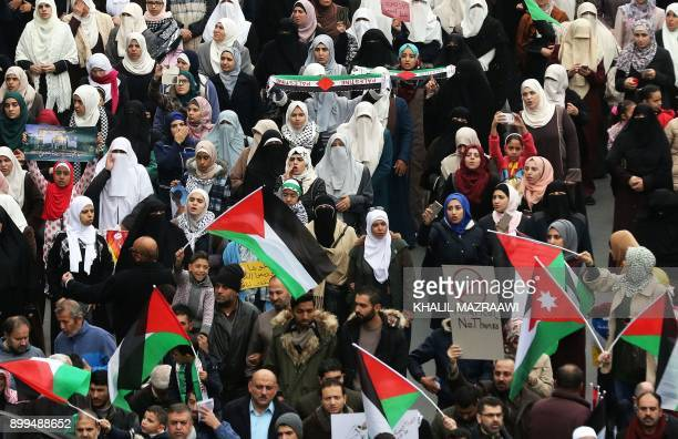 Jordanian protesters wave Palestinian flags during a demonstration against the US president's decision to recognise Jerusalem as the capital of...