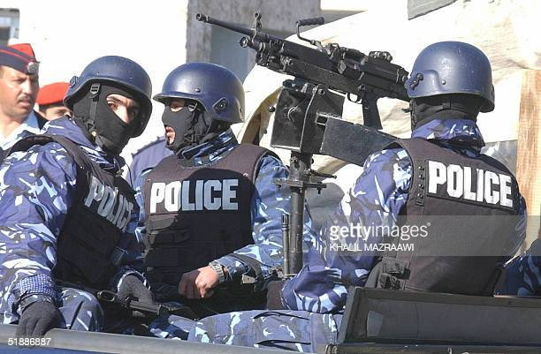 Jordanian riot police secure the area around a military court during the trial of Islamist militants in Amman 22 December 2004 The trial of Iraq's...