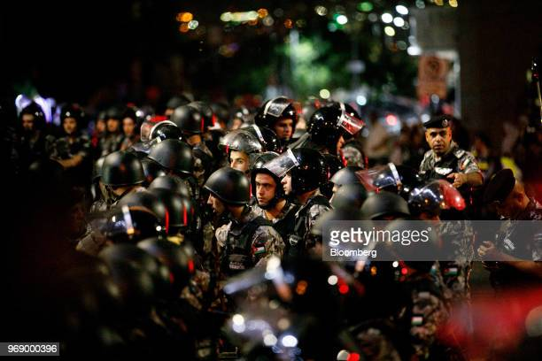 Jordanian riot police stand guard during a demonstration to protest a draft income tax law near the prime minister's office in Amman Jordan on...