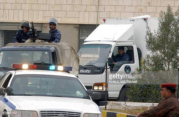 Jordanian security forces guard the Amman court where the trial of Iraq's most wanted man the fugitive Abu Musab alZarqawi and 12 other people...