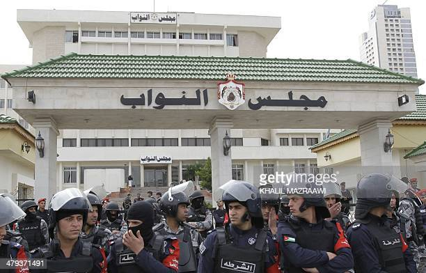 Jordanian security forces stand guard outside the parliament in Amman on March 18 2014 during a demonstration against Israel following the killing of...