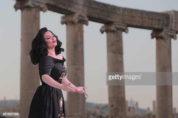 Jordanian singer Diana Karazon performs on stage during the opening of the 30th Jarash Festival of Culture and Arts in the ancient Roman city of...