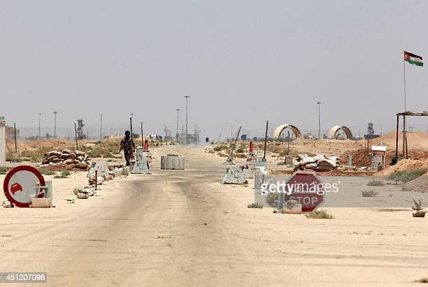 A Jordanian soldier on a military vehicle walks securing an area near the AlKarameh border point with Iraq on June 25 2014 as Jordan reinforced its...