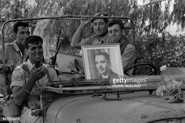 Jordanian soldiers carry a portrait of King Hussein of Jordan in their jeep on June 13 1967 on the road between Jerusalem and Bethlehem in the...