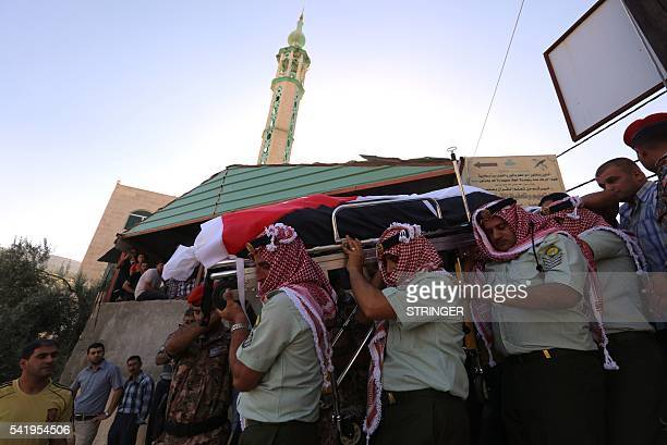 Jordanian soldiers carry the coffin of their comrade Belal AlZuhbi during his funeral in Nahleh village near the city of Jerash north of Amman on...