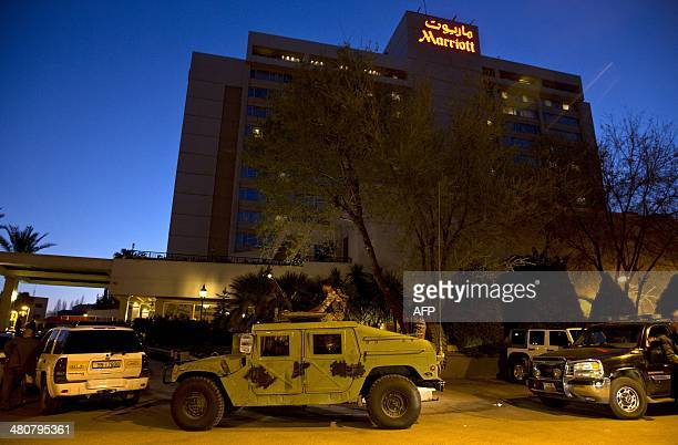 Jordanian soldiers guard the Marriott Hotel where US Secretary of State John Kerry is staying during his visit to Amman on March 26 2014 Kerry flew...