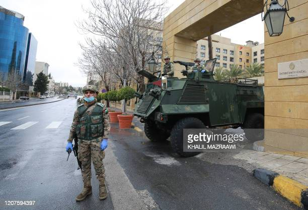 Jordanian soldiers keep watch on March 18 2020 at an empty avenue in the capital Amman as Jordan takes measures to fight the spread of the...