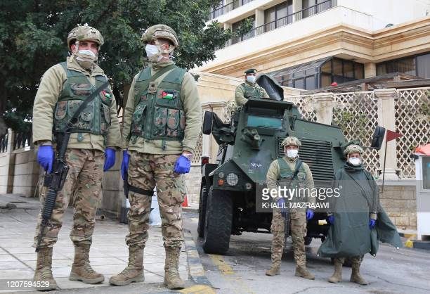 Jordanian soldiers keep watch on March 18 2020 in the capital Amman as Jordan takes measures to fight the spread of the coronavirus COVID19
