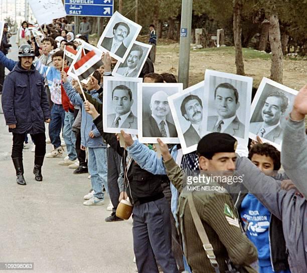 Jordanian supporters hold placards of Arab leaders Iraqi President Saddam Hussein Egyptian President Hosni Mubarak Jordanian King Hussein and North...