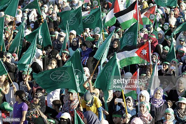 "Jordanian supporters of the Muslim Brotherhood gather during a protest to celebrate the ""Gaza victory"" in the war against Israel, in the capital..."