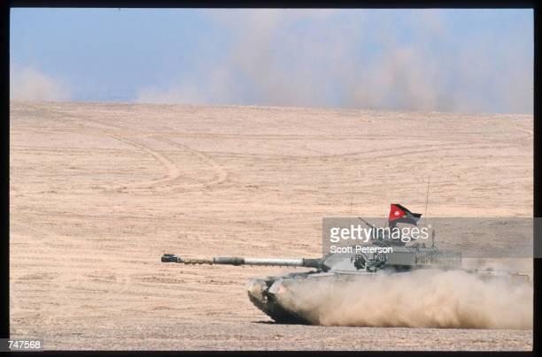 Jordanian tank races across the sand May 31 1997 in the Quatraneh Desert Jordan Operation Infinite Moonlight is one of many multinational training...