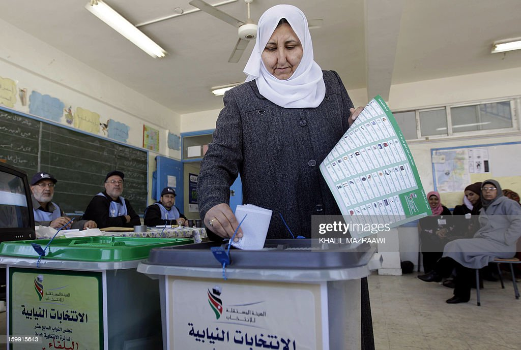 A Jordanian woman casts her ballot at a polling station in the Palestinian refugee camp of Baqaa, north of Amman, on January 23, 2013. Jordanians are voting in a parliamentary poll snubbed by Islamists who have staged strident pro-reform protests and who have already slammed what is expected to be an opposition-free body as illegitimate.