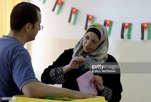 A Jordanian woman casts her ballot in the parliamentary elections at a polling station in the capital Amman on September 20 2016 Jordanians are...