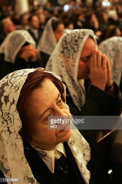Jordanian women pray during Mass of Requiem for Pope John Paul II at Sacred Heart of Jesus Church Tila AlAlali in Amman Jordan Wednesday April 6 2005...