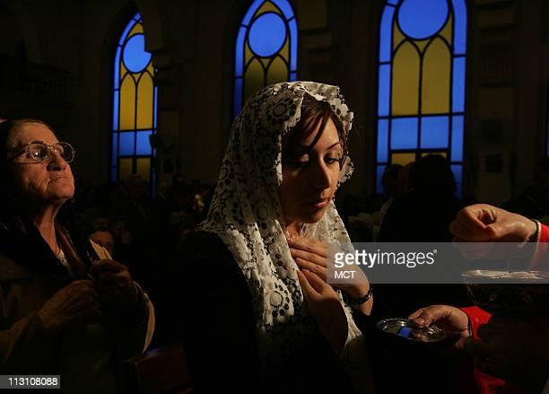 Jordanian women take holy communion during Mass of Requiem for Pope John Paul II at Sacred Heart of Jesus Church Tila AlAlali in Amman Jordan...