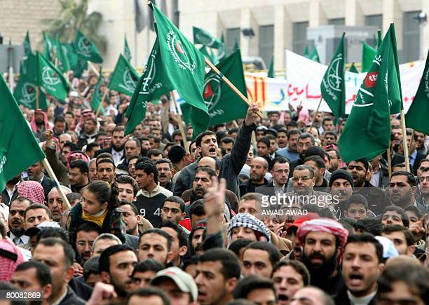 Jordanians and Palestinians chant slogans and wave Muslim Brotherhood flags during a demonstration in the Jordanian capital Amman against Israel's...
