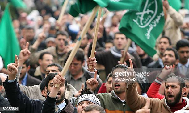 Jordanians and Palestinians chant slogans and wave the Muslim Brotherhood flags during a demonstration in the Jordanian capital Amman against...