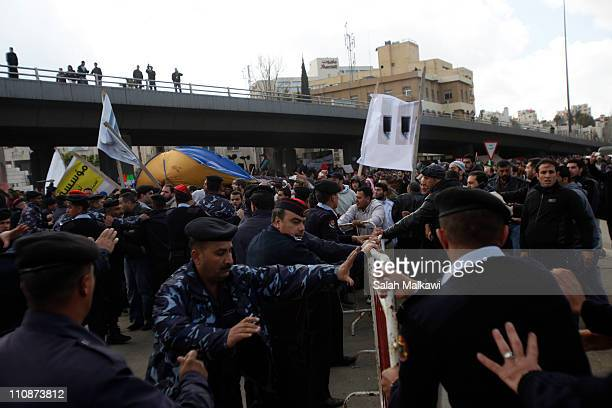 Jordanians gather in protest demanding government reforms at the central square on March 25 2011 in Amman Jordan Promonarchy demonstrators threw...