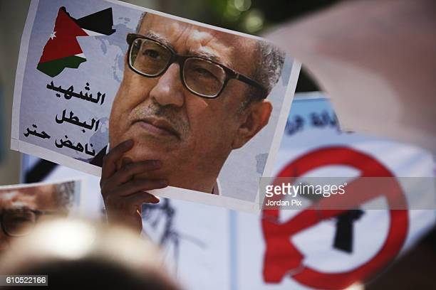 Jordanians hold an antigovernment protest after the murder of prominent writer Nahed Hattar at the Prime Minister's office on September 26 2016 in...