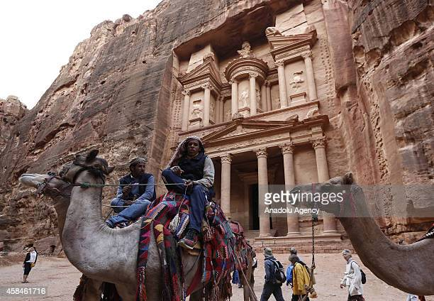 Jordanians mount camels in front of he facade of Al Khazneh built as a royal tomb and so called after a legend that pirates hid their loot in an urn...