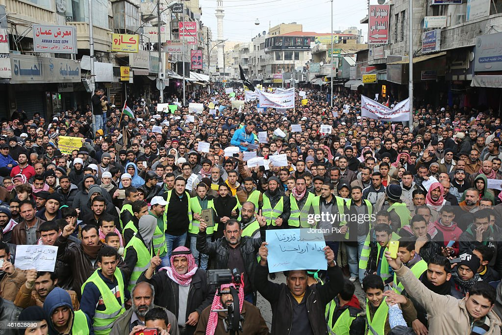 Jordanians protest against cartoons of the Prophet Mohammed appearing in 'Charlie Hebdo', after Friday prayers on January 16, 2015 in Amman, Jordan. Thousands of people took to the streets in downtown Amman to protest against the caricature of the Prophet Mohammed which featured on the front cover of the latest edition of French satirical magazine 'Charlie Hebdo', the first to be published since the publication suffered a terrorist attack. Yesterday, the Royal Jordanian Hashemite Court issued a statement calling the cartoon insulting, irresponsible and reckless.